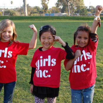 OnPoint's 2021community giving campaign-young girls showing empowerment while wearing girls inc. shirts