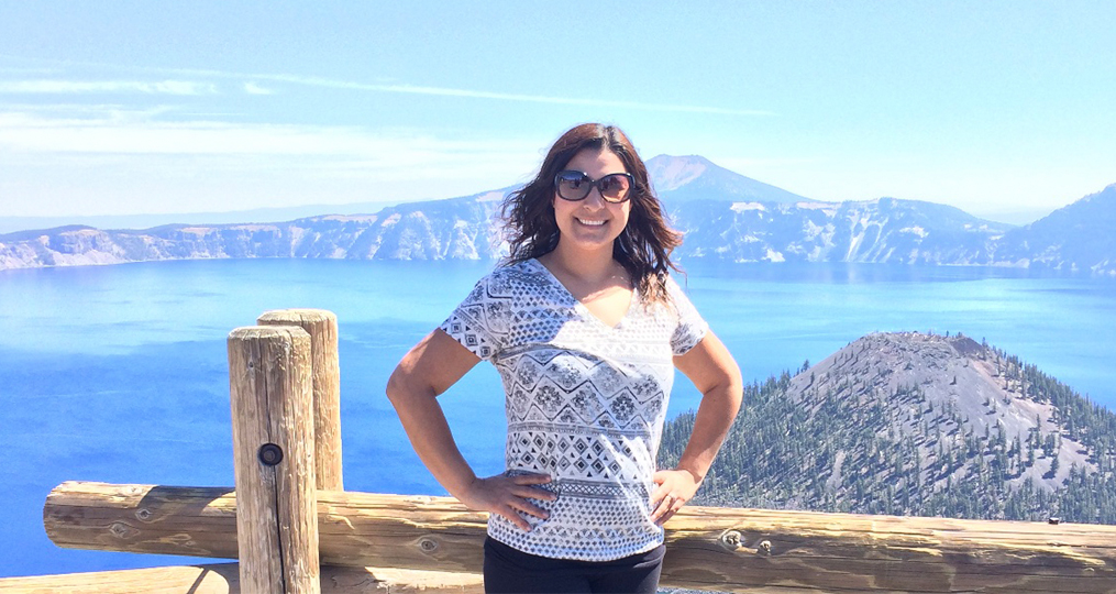 Marlen posing in front of a scenic mountain and lake view in the pacific northwest