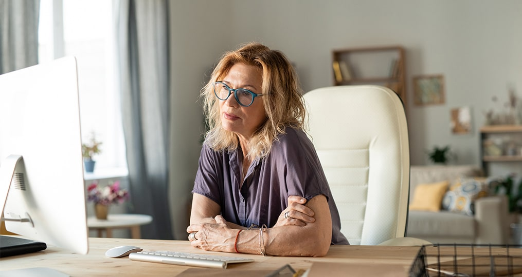 What Should You Ask a Financial Advisor-mature woman considering while looking at computer