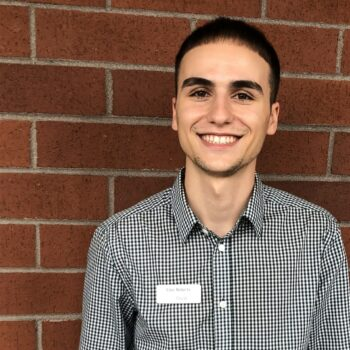 spotlight interview with Cole Roberts-Cole roberts headshot outside OnPoint 205 Place Branch