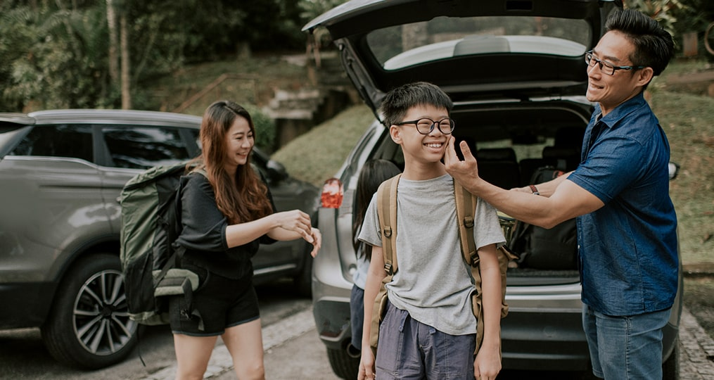 Auto Finance Advice What You Need To Know About Financing a Car_asian family preparing for a hike