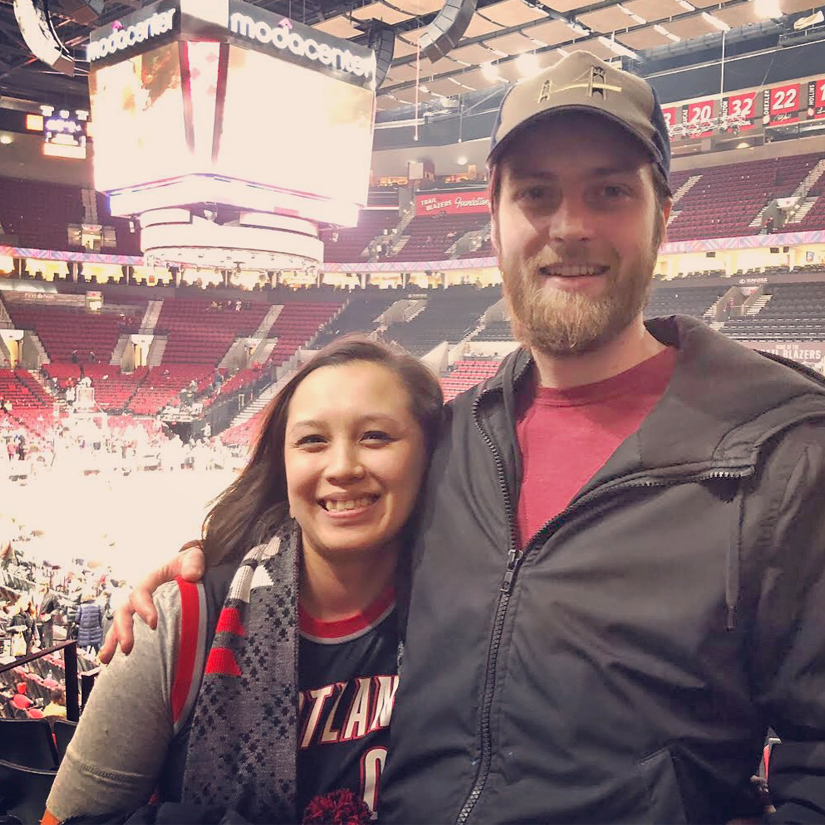 Britney Small and her husband at a blazers game