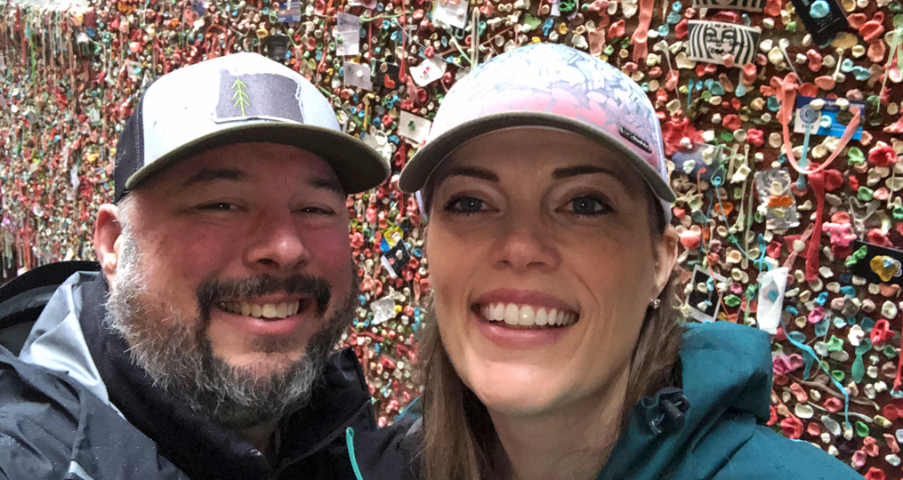 Heather Kesterson Employee Spotlight_Heather and her partner in front of gum wall