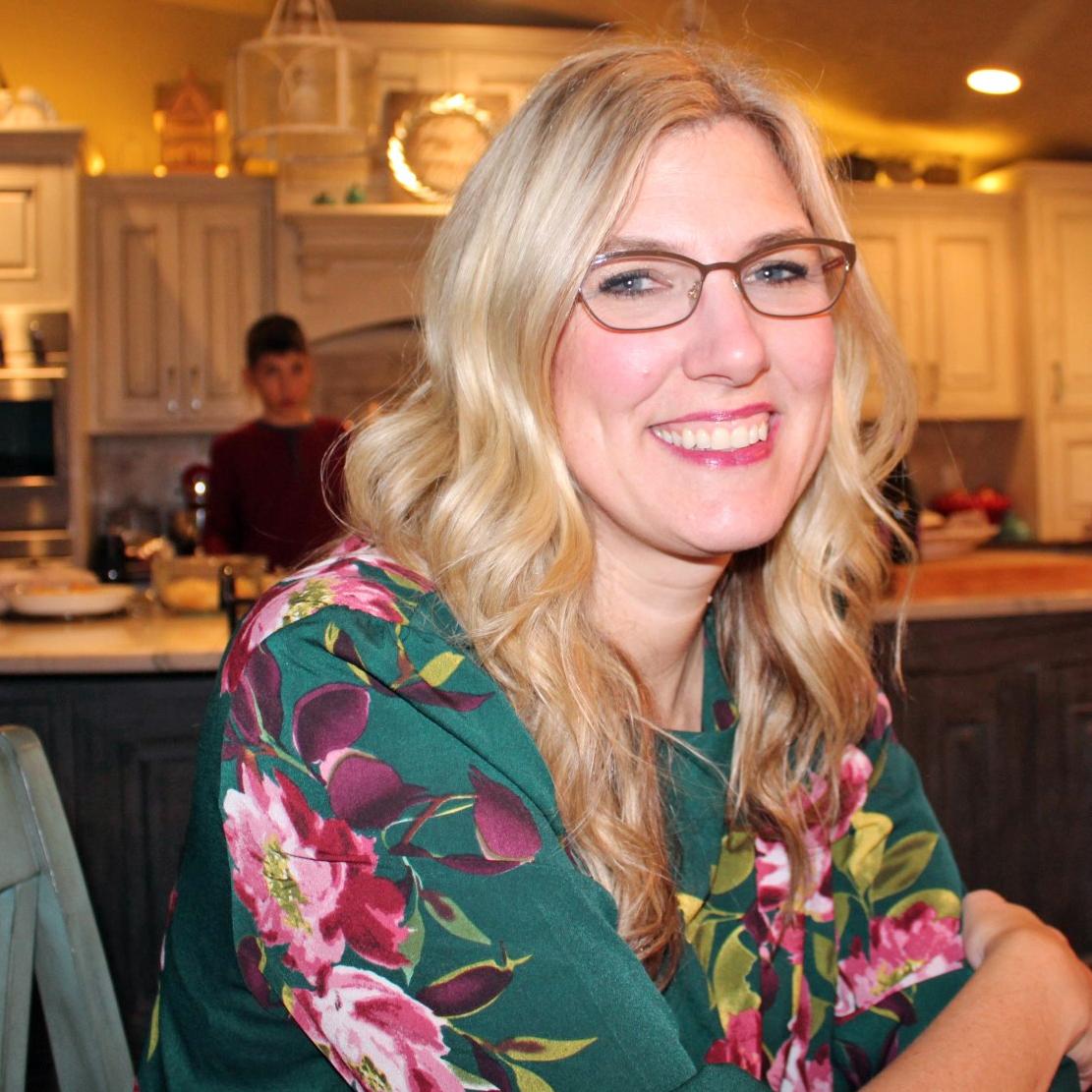 Leanne Skoog sitting at her kitchen table