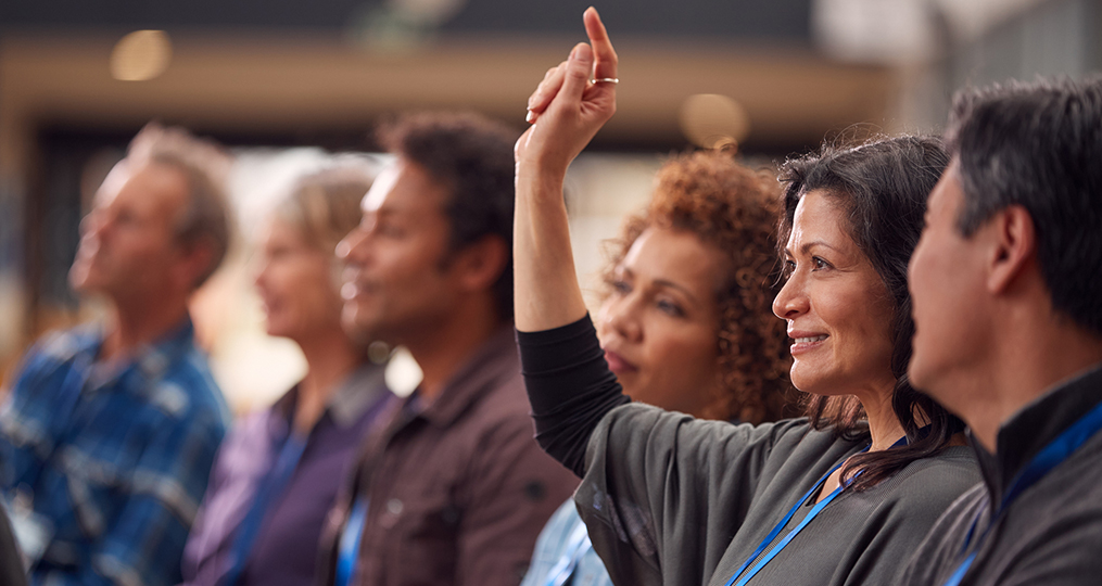 Understanding the Differences Among Popular Retirement Account Options_mature woman raising hand to ask a question