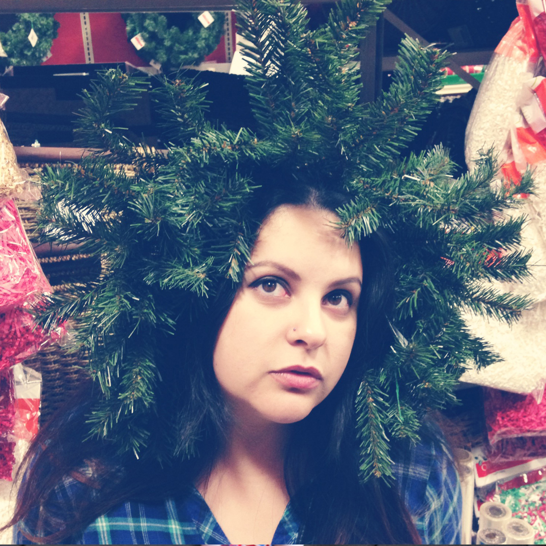 Vanessa Mijares wearing a wreath as a holiday hat