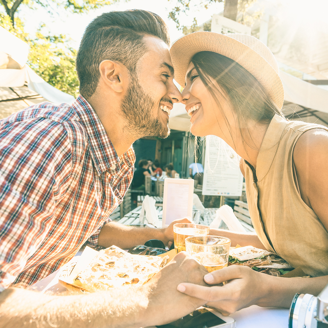 couple enjoying lunch together and leaning in for an eskimo kiss