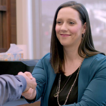 Natalie Berning shaking the hand of a new client