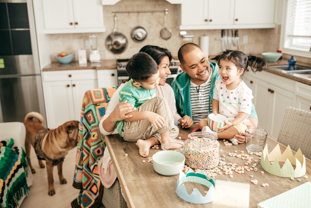Family enjoying their time together in the kitchen
