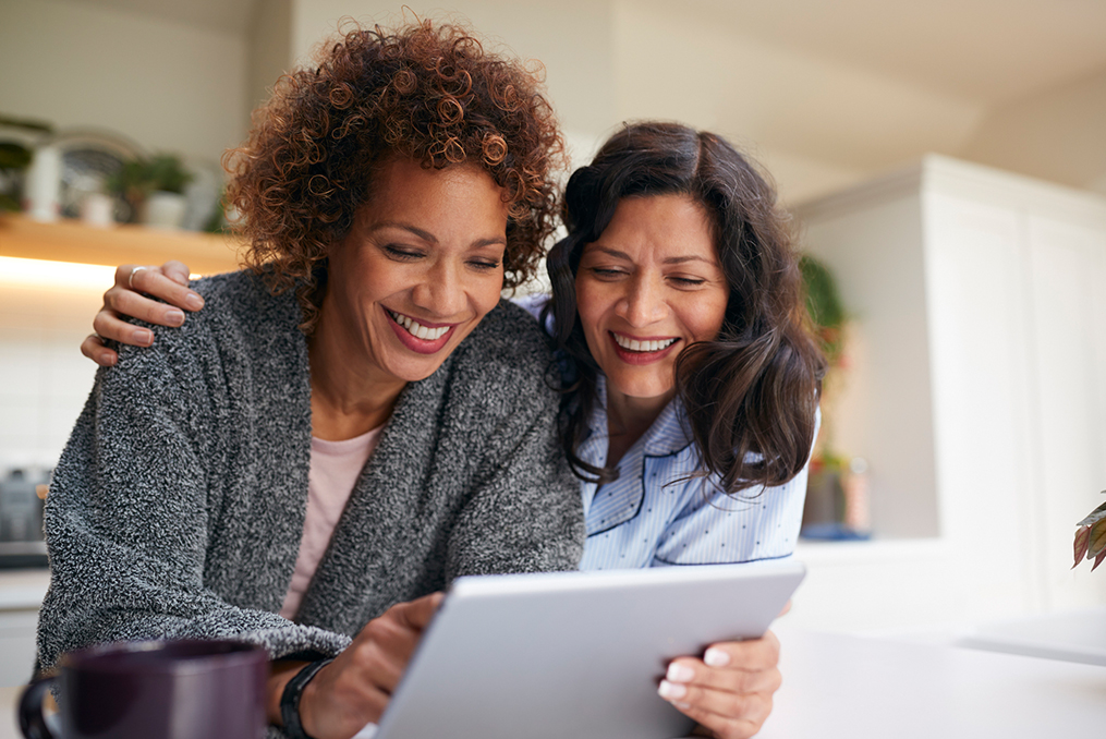 Understanding the Differences Among Popular Retirement Account Options_two mature women discussing retirement options