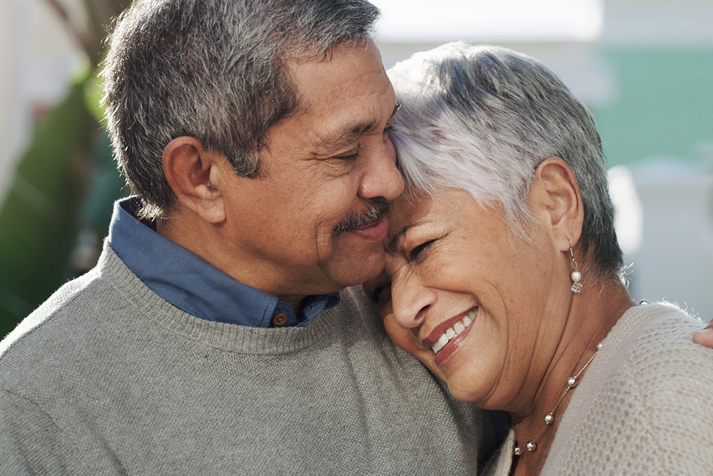 What to Do If You're Not on Track for Retirement_senior couple hugging and smiling