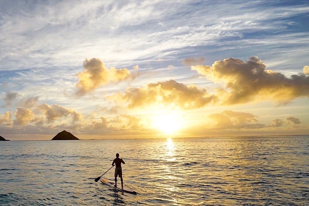 brian boehne paddle boarding into the sunset