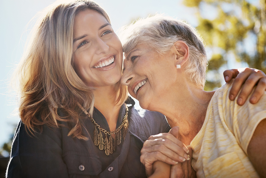 middle age woman embracing her mother