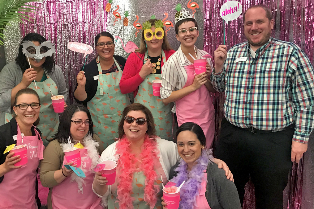 monica with member services team on Flamingo day