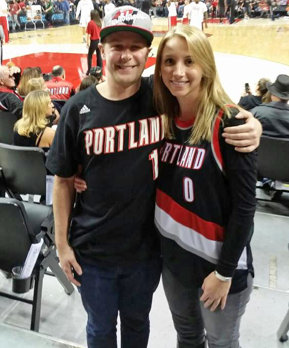 nick wilkins and his wife at a blazers game