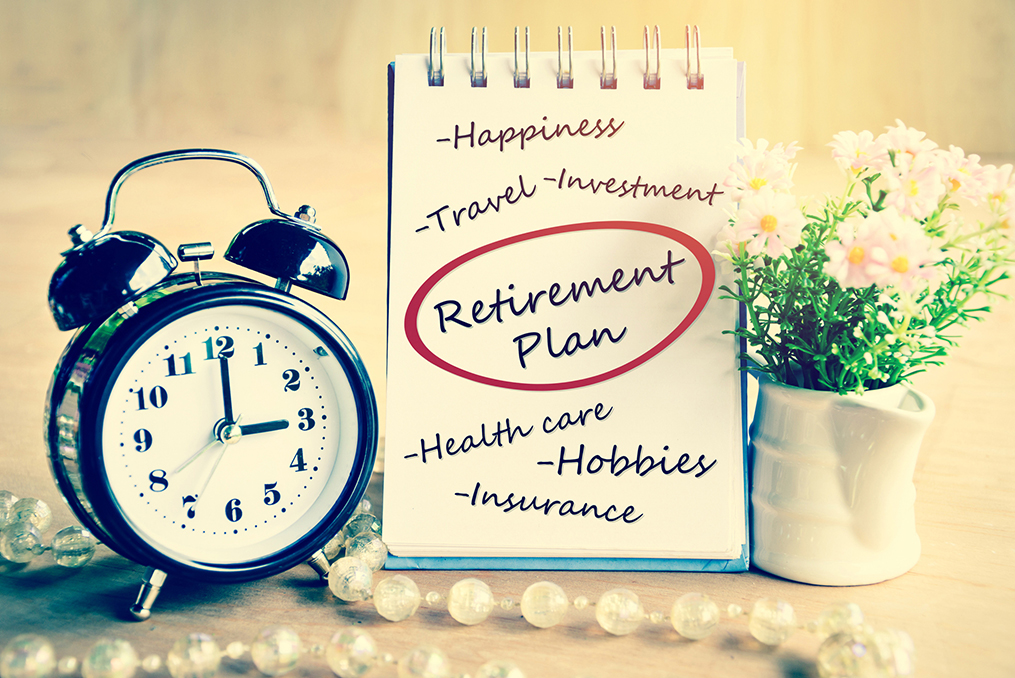 old fashion clock and notepad on a table - it is time to start thinking about your retirement