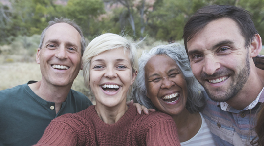 family and friends posing for a selfie