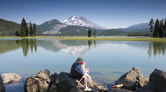 grandpa fishing with his grand-daughter near mt. jefferson