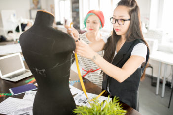 Two Creative Young Women in Workshop