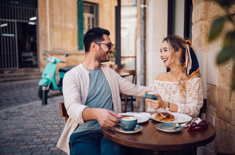 oung couple having brunch at traditional cafe in Europe