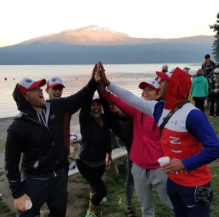 brian boehne team high five at the lake
